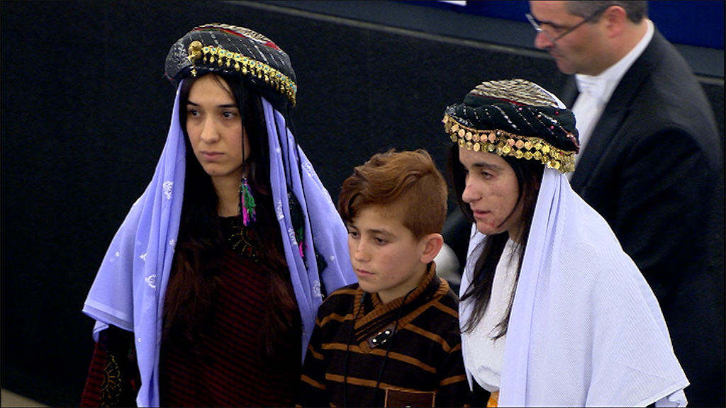 Lamiya Aji Bashar, her younger brother, and Nadia Murad
